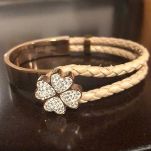 Rose gold and woven leather Folli follie bracelet